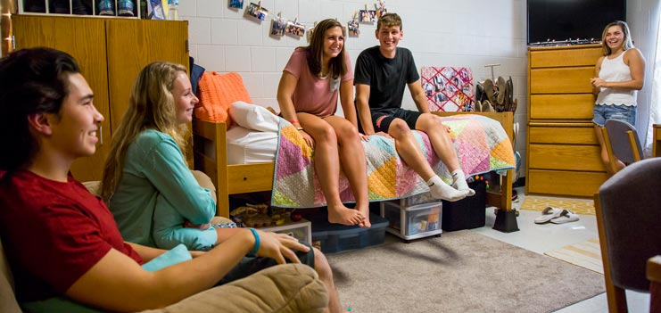 Students gathering in a residence hall
