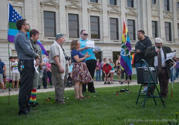Ahmed Abdelmageed, Pharm.D., director of Experiential Education in the Pharmacy Program, far left, spoke at a peace vigil in Fort Wayne a day after the mass shooting in Orlando.
