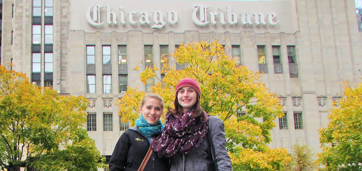 Manchester English majors Kari and Emily pose in front of the Chicago Tribune