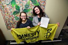 Virginia Rendler and Gabby Anglin Celebrate the Refugees Welcome Resolution
