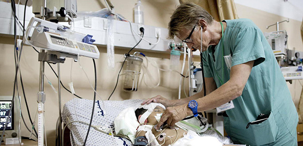 Dr. Mads Gilbert and patient