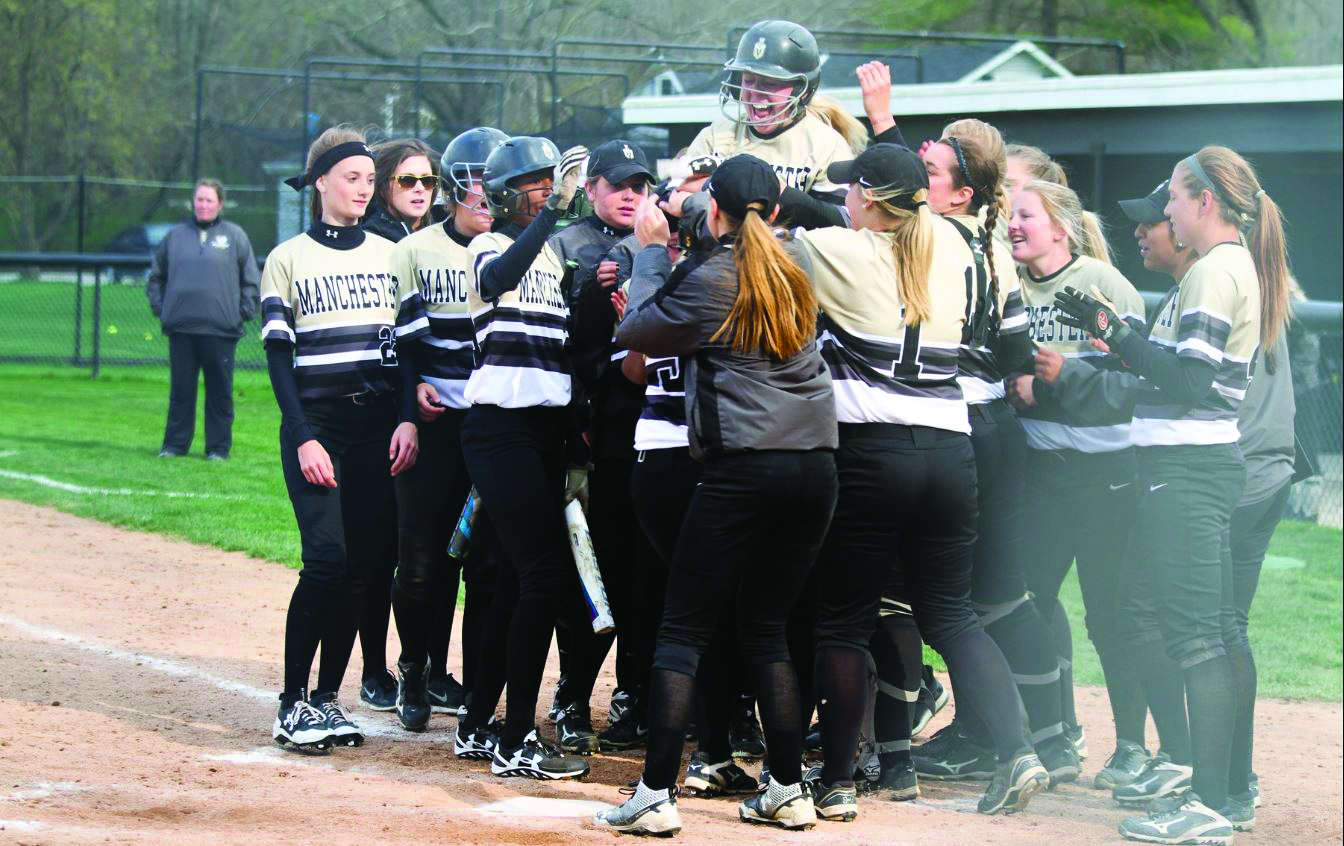 Softball Team Celebrates Win