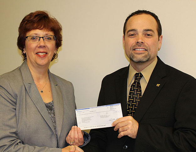 Walgreens representative Randy Jennings presents Dr. Raylene Rospond, MU vice president and dean of the MU College of Pharmacy, Natural and Health Sciences, with a Walgreens Diversity Donation of $8,000.
