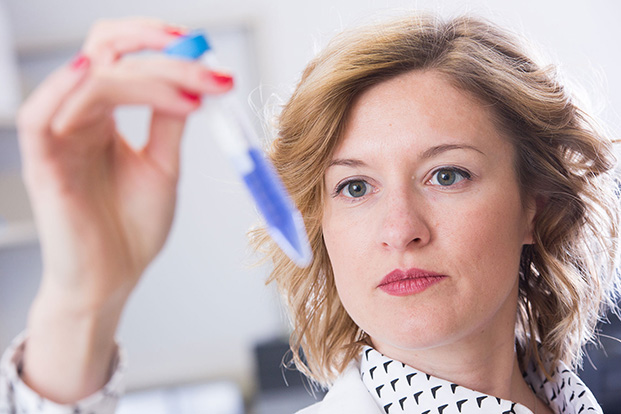 Diane Calinski, assistant professor of pharmaceutical sciences, demonstrates techniques used in pharmacogenomics.