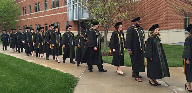 Pharmacy and Master of Athletic Training candidates move toward Cordier for  Commencement 2016.